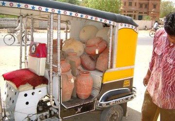 Loading up a Rickshaw with pots